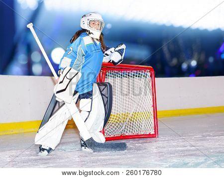 Girl Goaltender Next To The Net At Hockey Stadium