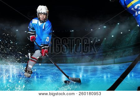 Hockey Player Passing The Puck During Competition
