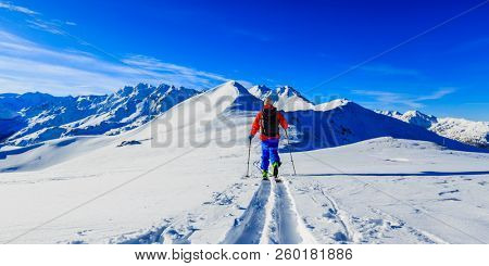 Ski with amazing view of swiss famous mountains in beautiful winter snow Mt Fort. The skituring, backcountry skiing in fresh powder snow.