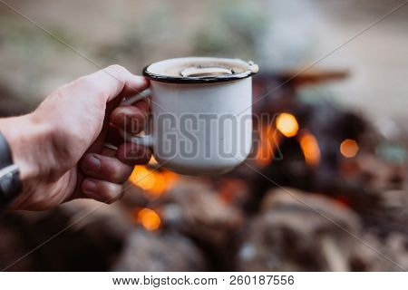 Hands Holding Cup Of Tea The Outdoors. Adventure, Travel, Tourism And Camping Concept. Hiker Drinkin