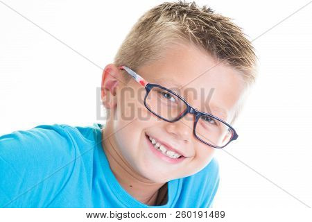 Cute Child Boy With Blue Shirt And Kid Glasses
