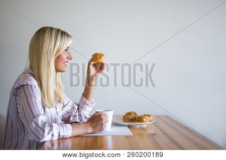 Breakfast Or Coffee Break Concept - Young Woman Drinking Coffee With Pastry At Home