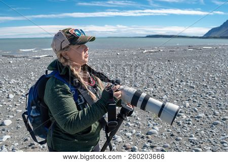 August 4 2018 - Katmai Alaska: Female Photographer On A Bear Viewing Excursion In Katmai National Pa