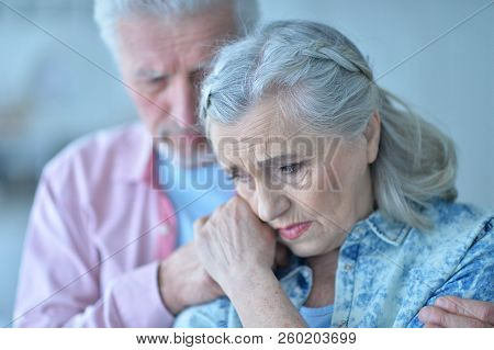 Portrait Of Sad Senior Couple At Home