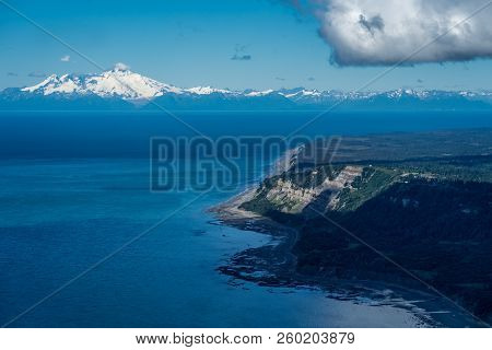 Aerial Photography View Of Alaska's Cook Inlet With A Clear View Of Mount Redoubt In Homer Alaska