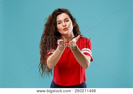 Happy Business Woman Standing And Kissing Isolated On Blue Studio Background. Beautiful Female Half-