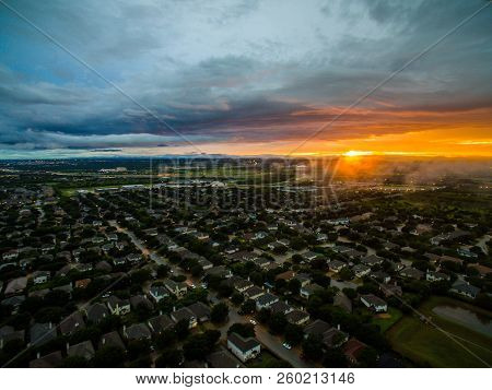 Aerial Drone View Above Suburb Neighborhood Thousands Of Homes And Houses On Ominous Sunset With Fog