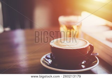 Coffee Cup On Brown Table Surface Background Vintage Style Selective Focus With Copy Space.