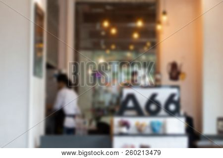 Abstract Blurred Image Of Coffee Cafe With Bokeh.