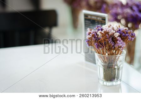 Vase Of Dried Flowers On Table In Restaurant Selective Focus Vintage Tone.