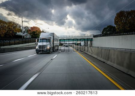 White 18 Wheeler Semi Truck Lorry On Highway Road