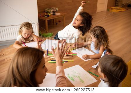 Educator Teaching Kids Counting And Showing Number With Fingers In Kindergarten, Happy African Ameri