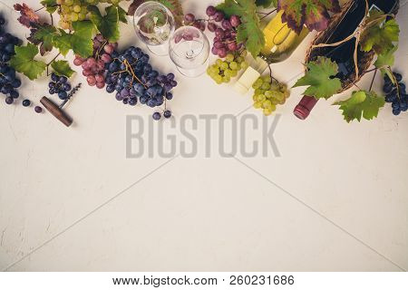 Wine With Glasses, Grapes, Leaves And Corkscrew On Dark Background, Copyspace, Flat Lay