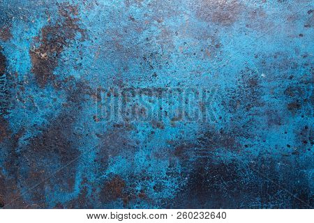 Blue metal surface, rusty metal background with traces of exploitation. Grunge metal texture.
