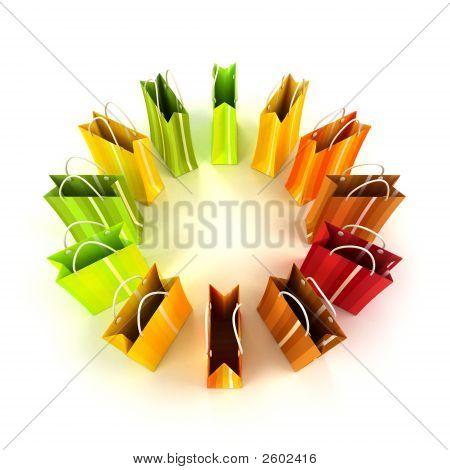 Círculo de coloridos bolsos de compras
