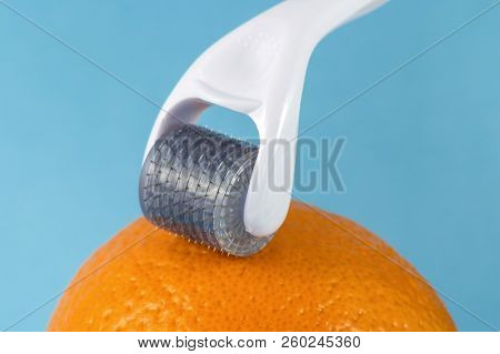 Derma Roller For Medical Micro Needling Therapy With Orange. Tool Also Known As: Derma Roller, Mesor