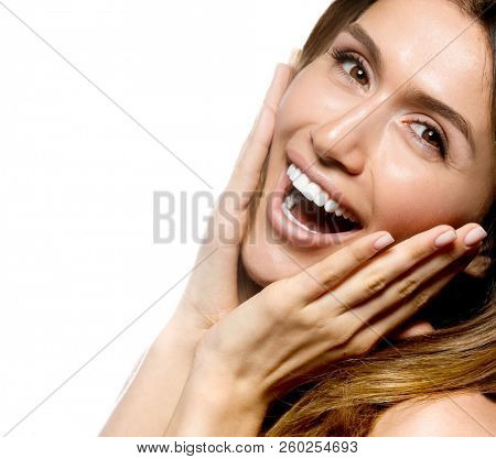 portrait of attractive caucasian smiling woman isolated on white studio shot  toothy smile face long hair head and shoulders looking at camera happy
