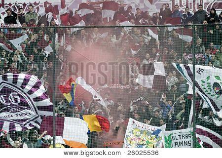 CLUJ-NAPOCA, ROMANIA - FEBRUARY 28: Supporters at a Romanian National Championship soccer game CFR Cluj vs. Steaua Bucuresti, February 28, 2010 in Cluj-Napoca, Romania.