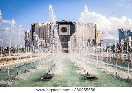 Sofia, Bulgaria. August 3, 2018. The National Palace Of Culture Seen Through The Fountain Water Jet