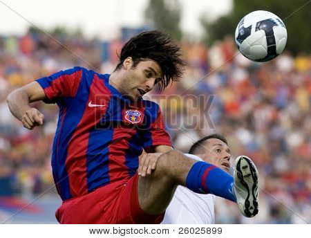 BUCHAREST, ROMANIA - JULY 16: Soccer players in action at a European League qualification match between Steaua Bucuresti and Ujpest Budapest on july 16, 2009, Bucharest, Romania.