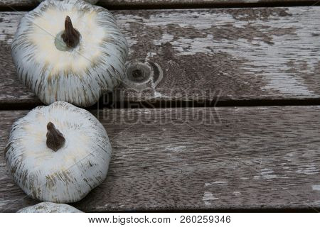 White Pumpkins On Wooden Background With Copy Space.