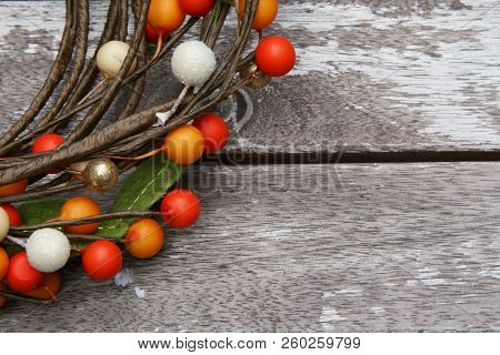 Colored Berries On A Wooden Background With Copy Space.