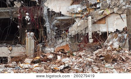 Destroyed Building Industrial. Building Demolition By Explosion. Abandoned Concrete Building With Ru