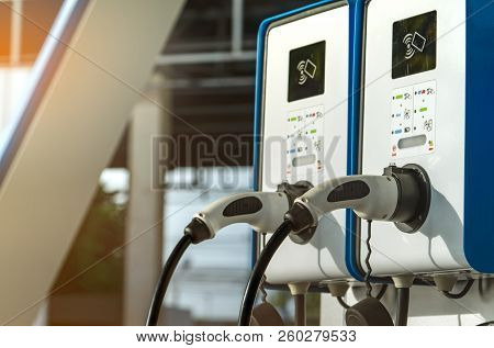 Electric Car Charging Station. Plug For Vehicle With Electric Motor. Coin-operated Charging Station.