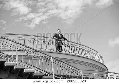 Confident Businessman Stand On Balcony On Cloudy Blue Sky. Man In Formal Wear Outdoor. Looking To Th