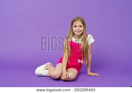 Tell Me Your Story. Girl Happy Face Sit On Floor Ready Listen Story Violet Background. Kid Girl With