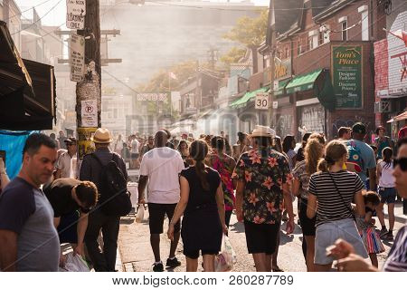Toronto, On, Canada - July 29, 2018: Street View Of The Crowd At Kensington Market In Toronto.