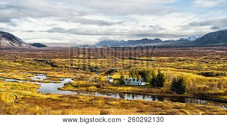 Haukadalur Valley In Iceland. Little Buildings In Peaceful Nature Environment. Valley Landscape Sunn