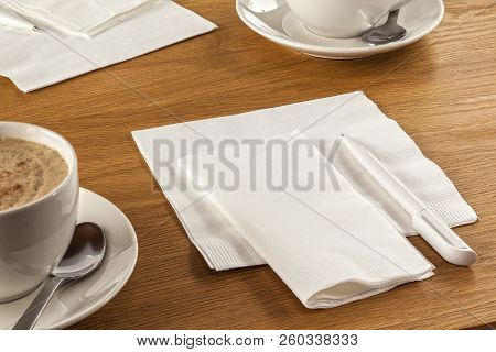 Serviette And Pen - Napkin Or Serviette And Pen On Table, Ready To Make A Note Of Your Latest Great