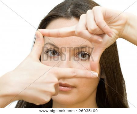 Portrait of young woman creates a frame with her hands. Isolated on white background