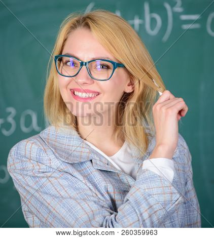 Principles Can Make Teaching More Effective And More Efficient. Woman Teaching Near Chalkboard. Effe