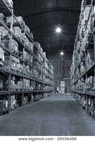 Industrial warehouse with plenty of boxes. Black and white photo