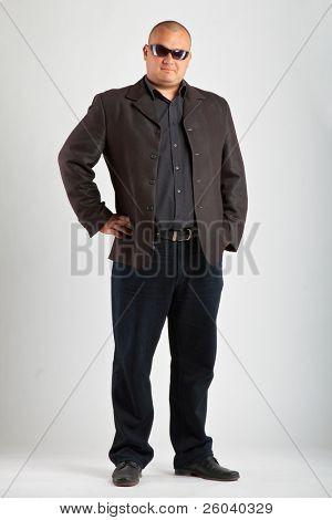 Man in black suit in sun glasses