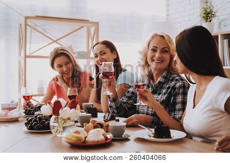 Smile Girl Drinking Wine And Eat Cake. Woman Speak With Family. People Speak With Family. Holiday An