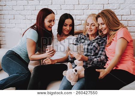 Girl Watching Photo With Family And Friends. Lady Celebrate 8 March With Family Or Friends. Holiday
