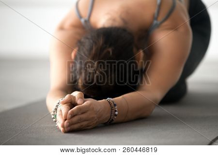 Young Attractive Woman Practicing Yoga, Doing Meditation Exercis