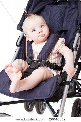 Portrait of baby in perambulator