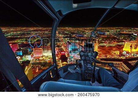 Helicopter Interior On Las Vegas Buildings And Skyscrapers Of Downtown With Illuminated Casino Hotel