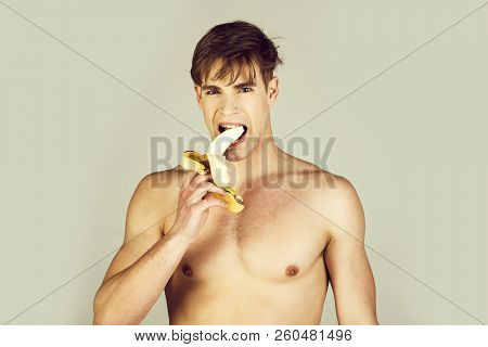 Man Or Athlete With Blond Hair, Stylish Haircut And Naked Muscular Chest, Biceps, Triceps Eating Ban