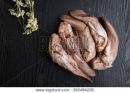 Raw Pork Or Beef Tongues On Black Wooden Table, Gourment Food Conception, Free Space For Text