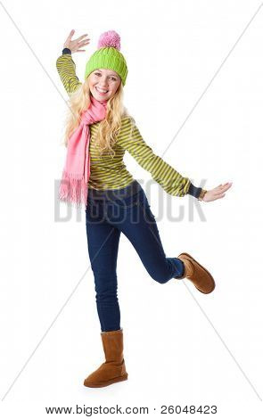 a laughing beautiful girl in funny cap is jumping. isolated on a white background
