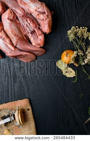 Raw Pork Or Beef Tongues With Black Pepper In Glass Jar, Oregano, Onion On Sackcloth, Bay Leaf On Bl