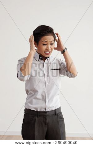 Attractive Asian Businessman Worring About Too Many Things