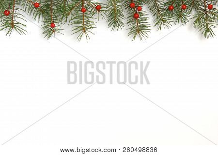 Christmas Background With Xmas Tree And Red Berries On White Wooden Background. Merry Christmas Gree