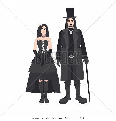 Young Goth Man And Woman With Long Hair Dressed In Black Clothing Standing Together. Boyfriend And G