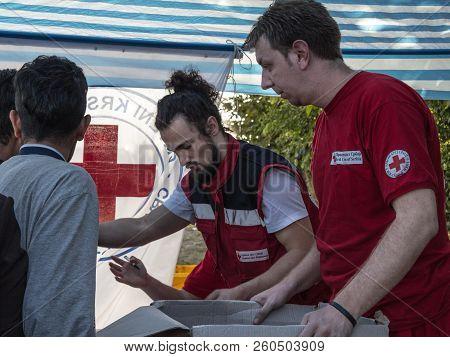 Berkasovo, Serbia - October 3, 2015: Workers Of The Red Cross Of Serbia (crveni Krst Srbije) Providi